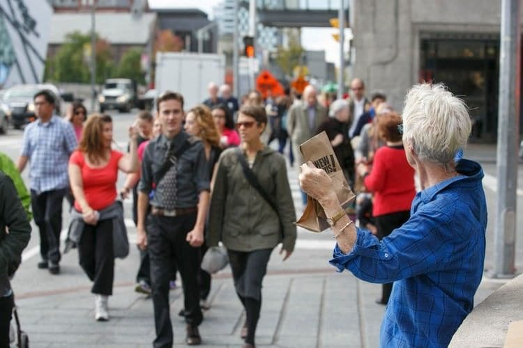 "Anti Poverty Activists Hand Out ""Chew On This!"" bags in downtown Toronto"